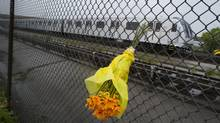 A bouquet of flowers is left at the scene where a Toronto Transit Commission tunnel foreman was killed Sept. 14, 2012. (Kevin Van Paassen/The Globe and Mail)