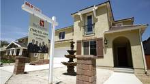 A newly sold home at a new housing subdivision is seen in San Marcos, California on Aug. 20, 2007. The economic contagion that started with a slump in U.S. home prices has spread throughout the financial sector due to default rates on risky subprime mortgages. (Mike Blake/Reuters)