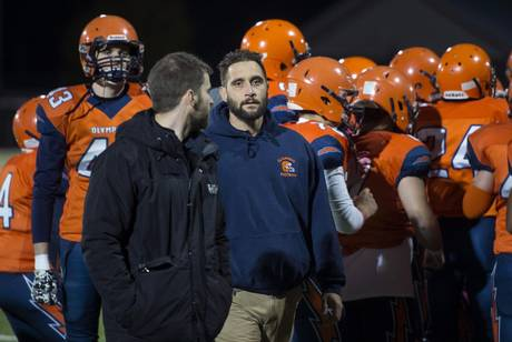 Ecole L'Odyssée Olympiens football head coach Marcel Metti, a paramedic, leaves the huddle before his team's game on Friday in Moncton.