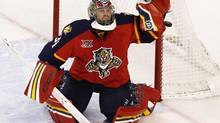 Dec 5, 2013; Sunrise, FL, USA; Florida Panthers goalie Tim Thomas (34) deflects the puck in the first period against the Winnipeg Jets at BB&T Center. (ROBERT MAYER/USA TODAY SPORTS)