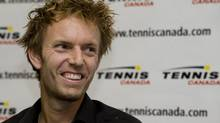 In this file photo, Canadian tennis player Frederic Niemeyer speaks at a press conference in Montreal, Thursday, Nov., 19, 2009 announcing his retirement from tennis. Nieymeyer was inducted into the Rogers Cup Hall of Fame in a ceremony in Montreal on Monday. (Graham Hughes/THE CANADIAN PRESS)