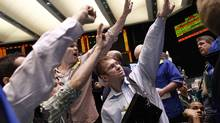 Traders work in the crude oil and natural gas options pit on the floor of the New York Mercantile Exchange in New York. (Shannon Stapleton /Reuters)