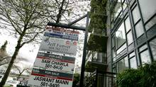 A file photo of many for sale signs hanging out front of a condo development in Vancouver. (LAURA LEYSHON/LAURA LEYSHON for The Globe and Mail)
