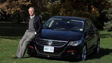 Don Newman pose with his 2011 Volkswagen CC 2000 in Ottawa. He bought the car to replace his BMW, which was totalled. (Dave Chan For The Globe and Mail)