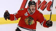 Chicago Blackhawks centre Andrew Shaw celebrates scoring in triple-overtime on Boston Bruins goalie Tuukka Rask (not pictured) to win Game 1 of their NHL Stanley Cup Finals hockey series in Chicago, Illinois, June 13, 2013. (Reuters)