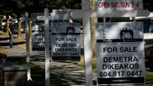 For sale signs are seen outside homes for sale in the Kitsilano neighborhood in Vancouver, B.C., on Tuesday September 18, 2012. (DARRYL DYCK For The Globe and Mail)