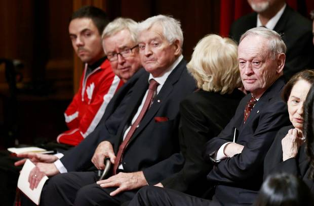 Former Canadian prime ministers Joe Clark, second left, John Turner, middle, and Jean Chrétien, right, look on ahead of the delivery of the speech.