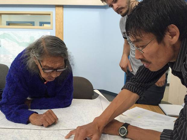 Madeline Drybones and Joseph Catholique map areas of their traditional Lutsel Ke Dene First Nation territory for a youth canoe trip.