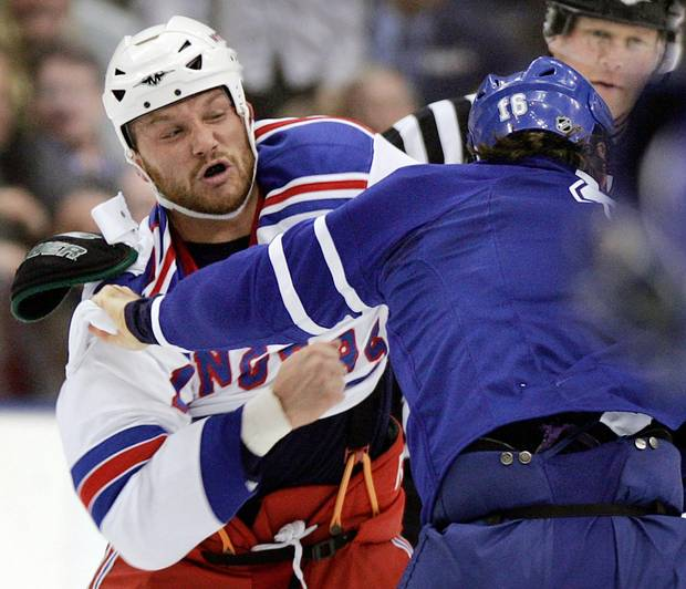 New York Rangers forward Sean Avery, left, fights with Darcy Tucker of the Toronto Maple Leafs during a game in November, 2007.
