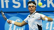 Canada's Milos Raonic returns the ball with a forehand shot to Germany's Philipp Petzschner during the ATP Stockholm Open tennis tournament in Stockholm on Wednesday. (JONATHAN NACKSTRAND/JONATHAN NACKSTRAND)