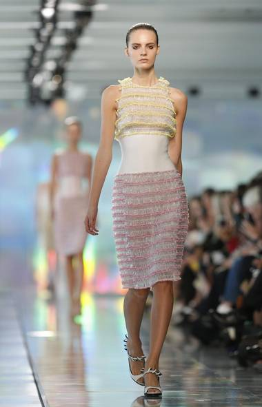 Christopher Kane favours materials and flourishes that have a playful sensibility but his treatment of them is invariably refined, feminine and often also formal. Here, plastic loops cover two-thirds of a dress; the middle, where a slim silhouette matters most, has been left unadorned. (Reuters)