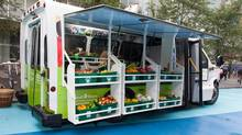 When it's parked, the FoodShare bus displays lettuce, onions and berries, and more exotic fare such as okra or yuca (cassava). (Laura Berman)