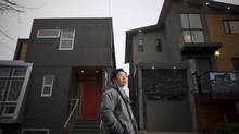 Tony Jang of Design + Build stands in front of the two houses he built on East 18th Avenue in Vancouver, British Columbia, Friday, December 13, 2013. (RAFAL GERSZAK/THE GLOBE AND MAIL)