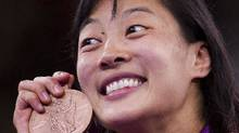 Canada's Carol Huynh defeated Senegal's Isabelle Sambou to win the bronze medal in the women's wrestling freestyle 48 kg category at the 2012 Summer Olympics in London on Aug. 8. (Kevin Van Paassen/The Globe and Mail)