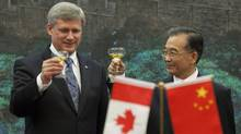 Prime Minister Stephen Harper takes part in a toast with Chinese Premier Wen Jiabao following a signing ceremony at the Great Hall of the People in Beijing, on  Dec. 3, 2009. (Sean Kilpatrick/The Canadian Press)