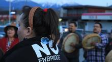 A Haisla woman wearing a traditional tree bark headband attends an anti-Northern Gateway pipeline protest in Kitimat, B.C., April 12, 2014. Residents of the town voted against the Northern Gateway pipeline project in a blow to Enbridge Inc's efforts to expedite the flow of crude from Canada's landlocked oil sands to high-paying markets in Asia. (Julie Gordon/REUTERS)