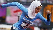 Palestine's Woroud Sawalha runs in her women's 800m round 1 heat at the London 2012 Olympic Games at the Olympic Stadium August 8, 2012. (Reuters)