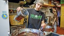 Mathieu McFadden pours agave nectar into the mix at ChocoSol, an artisanal chocolate company in Toronto. DELLA ROLLINS FOR THE GLOBE AND MAIL