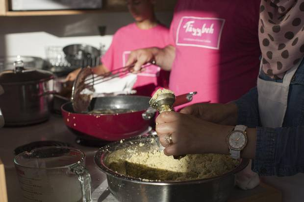 Leena Alahmad, right, prepares falafel pucks for the Shades of Green Festival dinner in Vancouver on May 26.