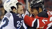 New Jersey Devils' Mark Fraser, right, fights with Winnipeg Jets' Chris Thorburn during the first period of an NHL hockey game, Saturday, Nov. 5, 2011, in Newark, N.J. (AP Photo/Bill Kostroun) (Bill Kostroun)