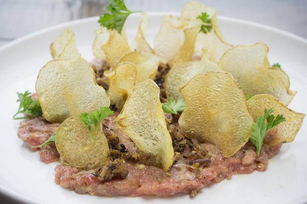 Beef tartare, with roast Garlic, grainy mustard, mushroom tapenade, and parsley at Hayloft Restaurant.