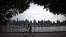 The initiative is part of an effort that has spanned 20 years to separate out bike paths and pedestrian paths between Canada Place downtown and, eventually, Jericho Beach on the west side of Vancouver. (Rafal Gerszak For The Globe and Mail)