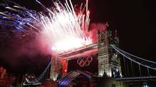 Fireworks explode over Tower Bridge during the opening ceremony of the London 2012 Olympic Games July 27, 2012. (EDDIE KEOGH/REUTERS)