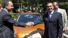 Renault/Nissan CEO Carlos Ghosn, right, and Rio governor Sergio Cabral shake hands in Rio de Janeiro on Thursday. (SERGIO MORAES/REUTERS)