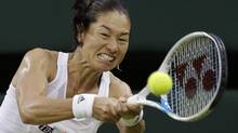 'I like a challenge. Every moment for me, it's a challenge,' says Kimiko Date-Krumm of Japan. She's shown in a match against Serena Williams last month. (Sang Tan/ASSOCIATED PRESS)