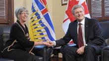 Prime Minister Stephen Harper introduces Judith Guichon as the lieutenant-governor of British Columbia at his office in Ottawa on Oct. 1, 2012. (Sean Kilpatrick/THE CANADIAN PRESS)
