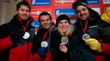 From left to right, Canada's Tristan Walker, of Cochrane, Alta., Justin Snith, of Calgary, Alta., Alex Gough, of Calgary, Alta., and Samuel Edney, of Calgary, Alta., hold their silver medals after finishing in second-place during a Luge World Cup relay event in Whistler, B.C., on Saturday December 7, 2013. (DARRYL DYCK/THE CANADIAN PRESS)