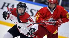 Marie-Philip Poulin of Canada in action against Shansan Cui of China during IIHF World Women Championship of ice hockey in Hameenlinna, Finland, 4th of April 2009. (Jussi Nukari/Lehtikuva OY)