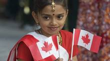Shahnaz Begum smiles as she enjoys the annual Canada Day celebrations in Montreal, Friday, July 1, 2011. (Graham Hughes/Graham Hughes/The Canadian Press)