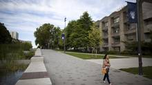 A woman makes her way past the Chemistry and Physics building at the University of British Columbia in Vancouver, British Columbia, Friday, August 23, 2013. (Rafal Gerszak For The Globe and Mail)