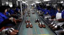 Employees work at a shoe factory in Lishui, Zhejiang province, January 24, 2013. (Reuters/Reuters)