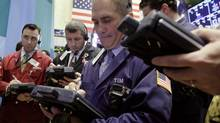 In this Wednesday, Oct. 3, 2012, file photo, traders work on the floor of the New York Stock Exchange. (Richard Drew/AP)