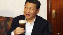 China's vice-president Xi Jinping samples an Irish Coffee while on a tour of Ireland on Feb. 19, 2012. (POOL/REUTERS)
