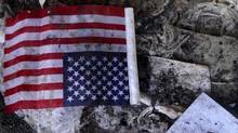 A U.S. flag is seen at the U.S. consulate, which was attacked and set on fire by gunmen yesterday, in Benghazi September 12, 2012. (Reuters)