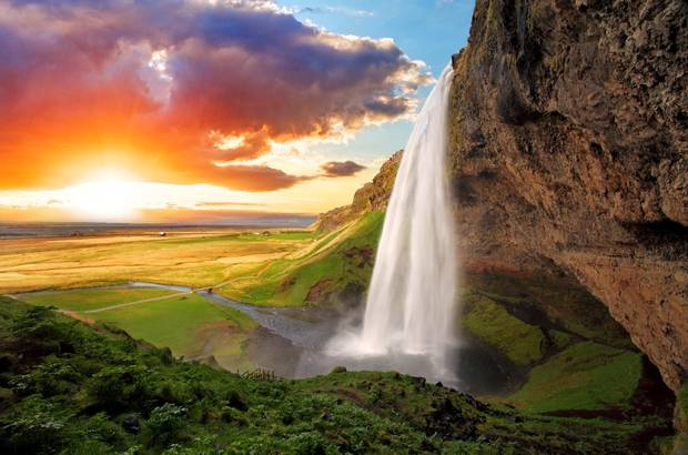 Seljalandsfoss, Iceland's Eyjafjallajokull volcano provides photographers with a chance to shoot behind it's waterfall.