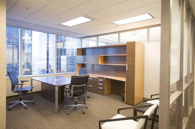 An empty desk at an oil and gas company in downtown Calgary that, with recent layoffs, has had to consolidate its 11 floors into just five.