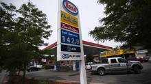 An Esso gas station displays gas prices in Toronto, June 23, 2014. (MARK BLINCH/REUTERS)