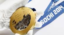 A gold medal manufactured for the 2014 Winter Olympic Games in Soch (SERGEI KARPUKHIN/REUTERS)