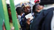 A man waits to enter a polling station in Cite Soleil, a slum in Port-au-Prince, during Haiti's presidential run-off election on March 20, 2011. (SHANNON STAPLETON/Reuters)