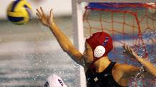 Goalkeeper Rachel Riddell of Canada tries to stop a shot by Brazil during a Pan American games women's water polo semi-final game in Rio de Janeiro, Thursday July 19, 2007. (Dario Lopez-Mills/Dario Lopez-Mills/AP)