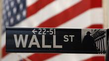 A Wall Street sign is seen outside of the New York Stock Exchange September 19, 2008. REUTERS/Lucas Jackson (UNITED STATES) (LUCAS JACKSON/Lucas Jackson/REUTERS)