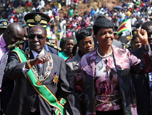 President Mugabe and his wife Grace arrive to address a gathering to mark the National Heroes Day celebrations in Harare, Zimbabwe on August 8, 2016.
