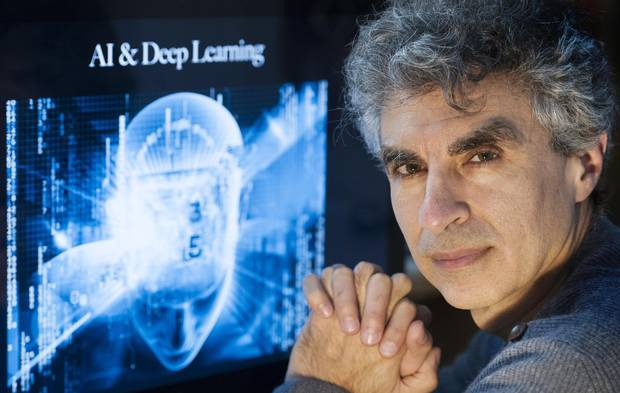 Computer Science professor Yoshua Bengio poses at his home in Montreal.