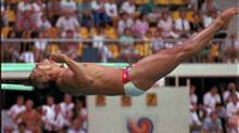 FILE -- Diver Greg Louganis, of the United States, hits the end of the springboard with his head during preliminary competition at the Summer Olympic Games in Seoul, in this Sept. 19, 1988 photo. (Associated Press)