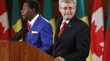 Stephen Harper takes part in a news conference with Chairman of the African Union and Benin's President Thomas Yayi Boni on Parliament Hill in Ottawa on Jan. 8, 2013. (CHRIS WATTIE/REUTERS)