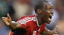 Canada's Atiba Hutchinson reacts after a call by referee Benito Archundia during the second half of the Gold Cup Soccer game against USA, Thursday, June 21, 2007, in Chicago. (Associated Press)